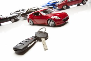 1699275-car-keys-and-several-sports-cars-on-white
